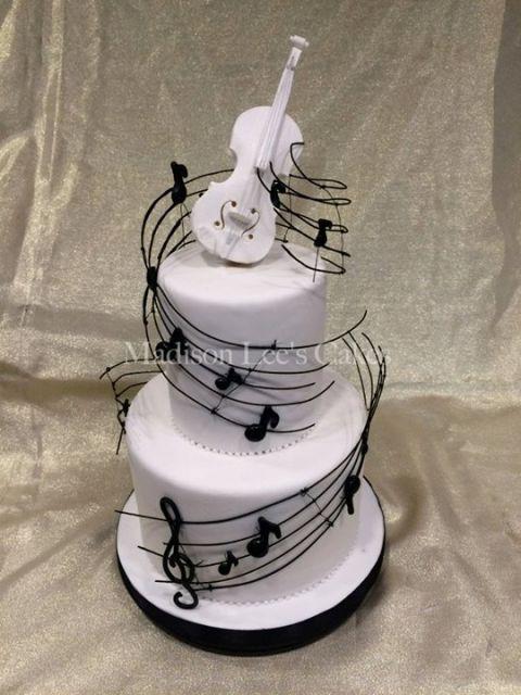 bolo-com-notas-musicais-guitarra-e-violao