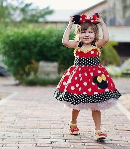 fantasia da Minnie infantil de vestido vermelho com detalhes em preto e amarelo