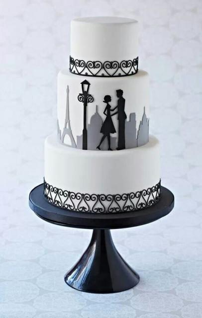 bolo paris de três andares com a camada do meio decorada