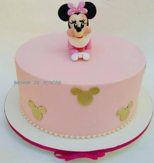 bolo rosa e dourado Minnie bebê
