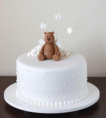 bolo de batizado branco com um ursinho encima