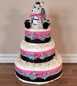 bolo fake feminino com estampa de zebra e uma zebra de pelúcia encima