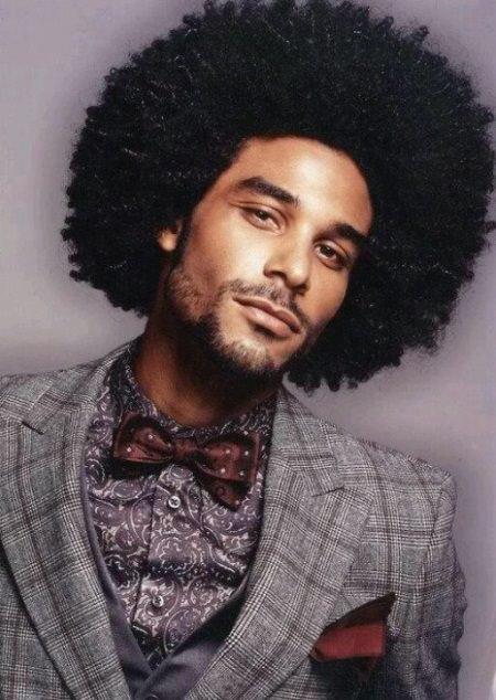 Fantasias anos 60 masculinas penteado afro
