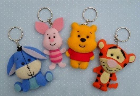 Chaveiros com os personagens do desenho Ursinho Pooh.