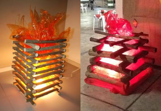 decoração de festa junina simples fogueira feita com madeira e plástico