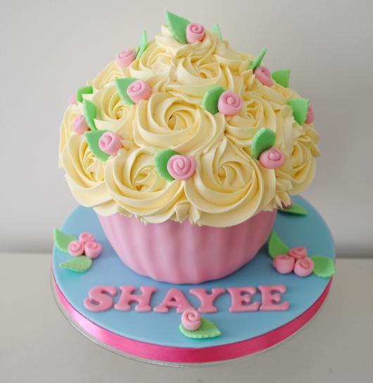 Dica de cupcake gigante fofo em amarelo e rosa