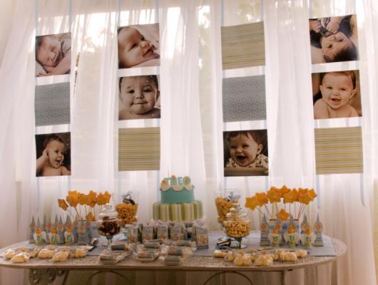 Painel com fotos da criança para batizado