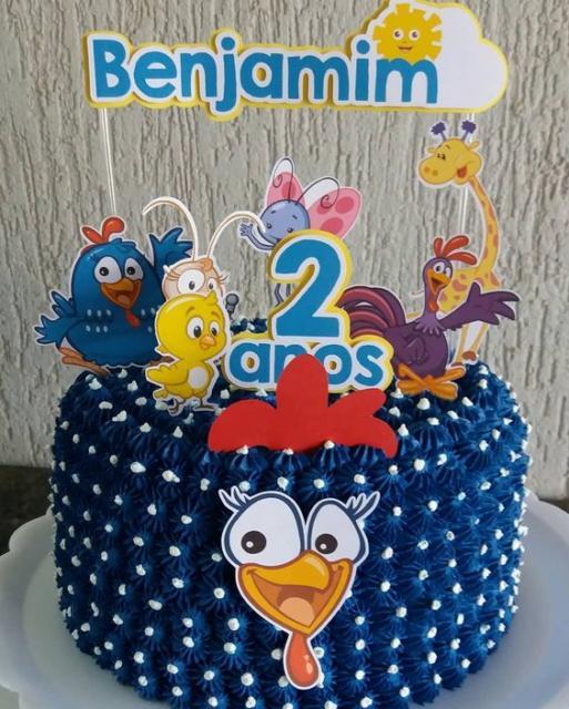 topo de bolo galinha pintadinha com diversos personagens.