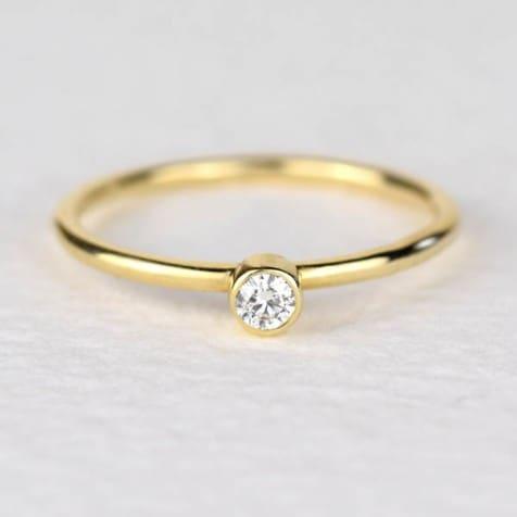 anel de ouro com brilhante