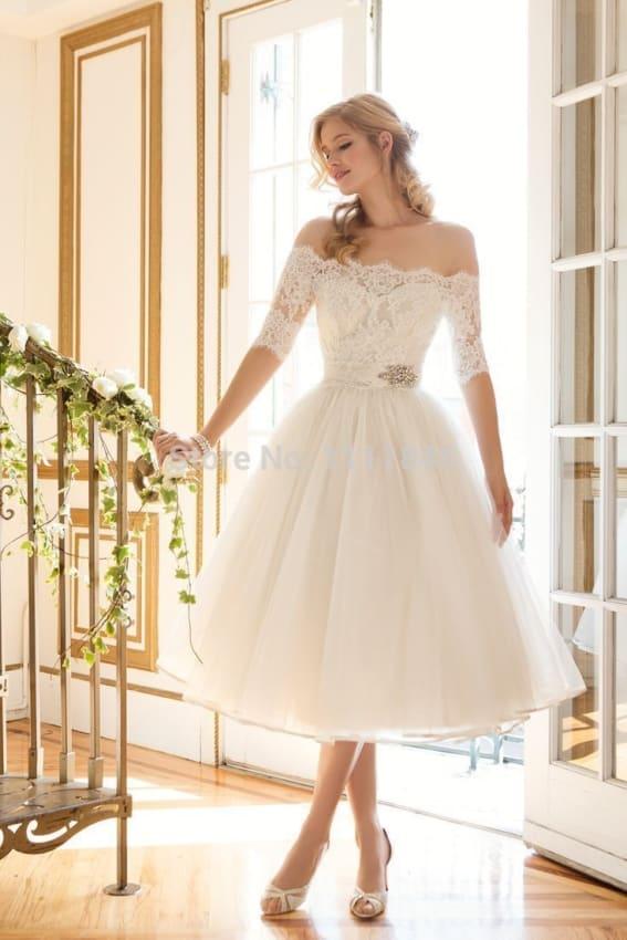 Noiva com vestido com manga três quartos curto