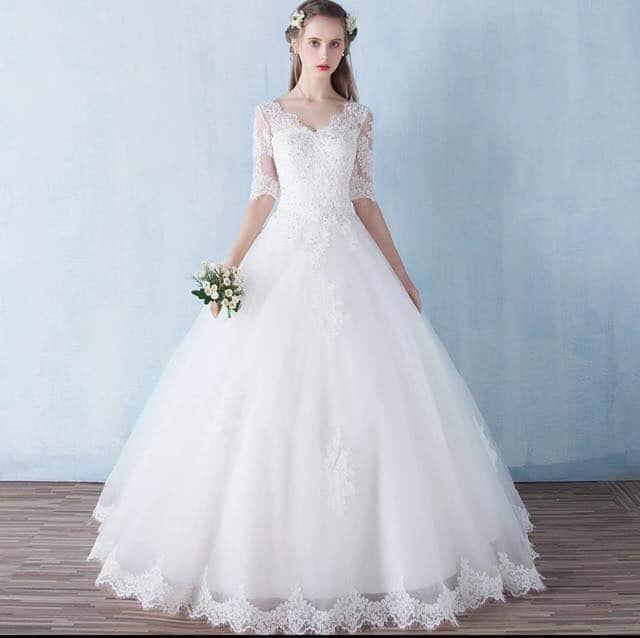 Vestido de noiva com manga três quartos