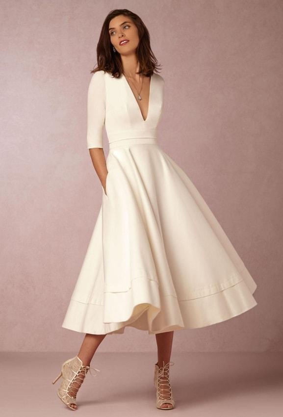 Vestido midi para noivas que querem alongar a silhueta