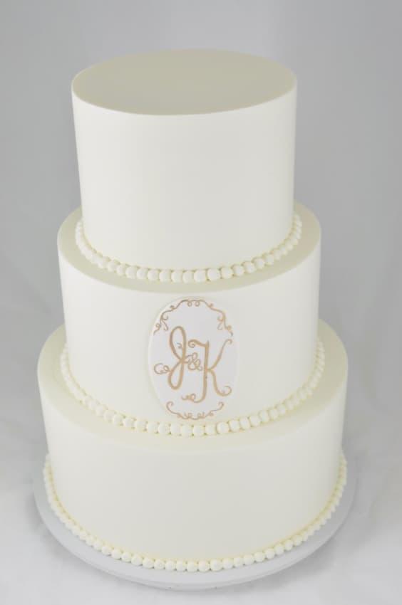 Brasão de casamento em bolos