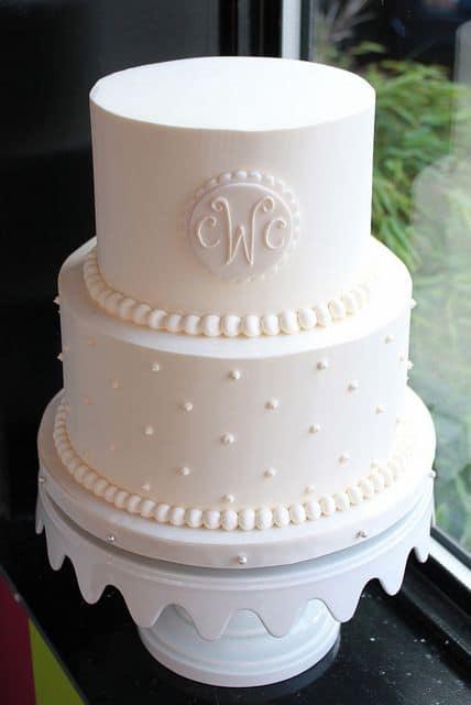 Brasão de casamento no bolo
