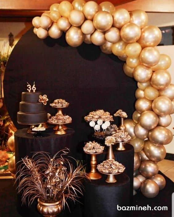 decoração em preto e dourado para festa de aniversário anos 20