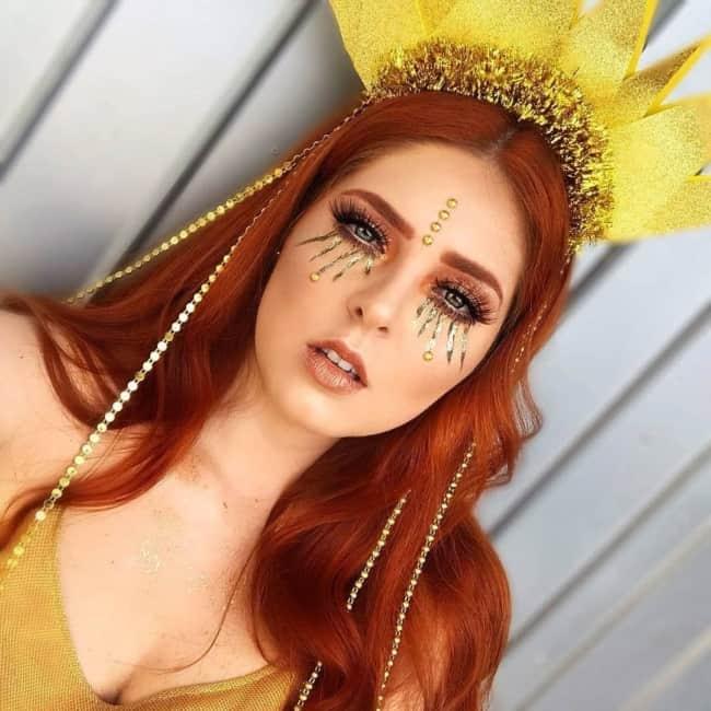 fantasia de sol feminina com acessorio de cabeca