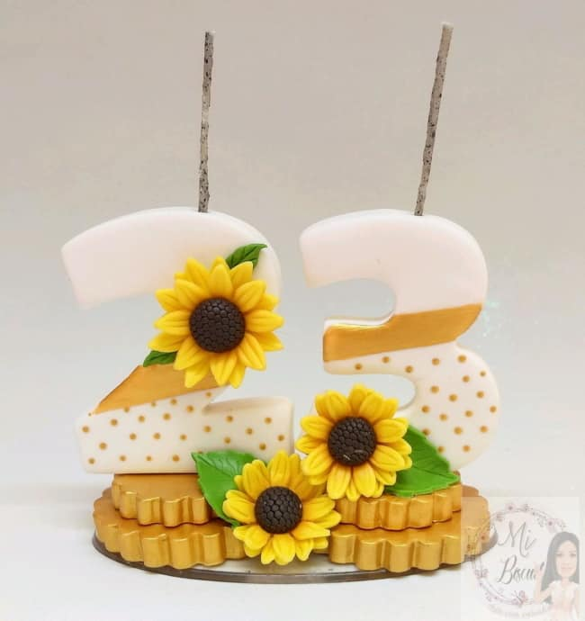 decoracao de girassol em biscuit para topo de bolo