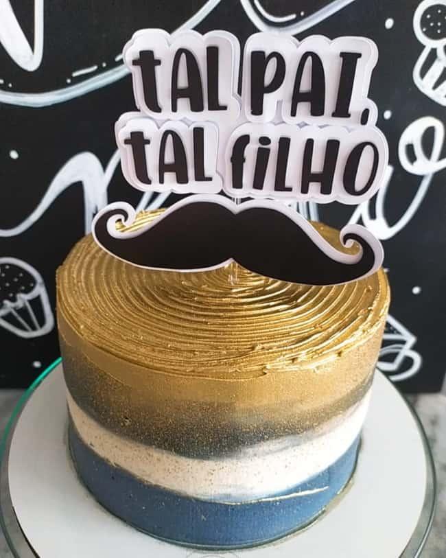 bolo decorado com topo pai e filho