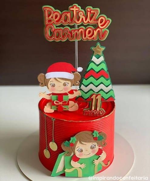 bolo vermelho com topo de mesversario com tematica de natal